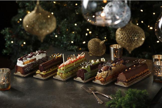 左から:グリオットチェリー入りチョコレートケーキ、ラズベリーとピスタチオのチョコレートノエル、ピスタチオと苺のダックワーズ、抹茶とチョコレートのノエル、カシスとヘーゼルナッツのモンブラン、ミルクチョコレートとビターチョコレート ブッシュドノエル