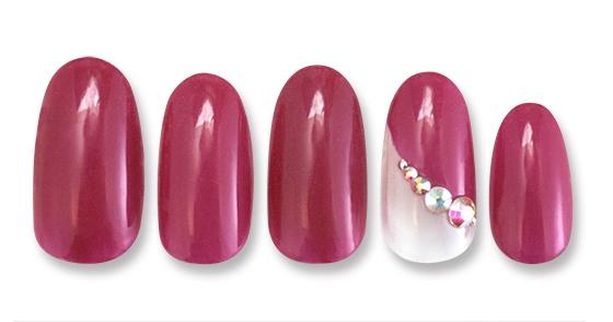 ルージュカラーに薬指のストーンが女性らしさをかもし出す綺麗系デザイン。