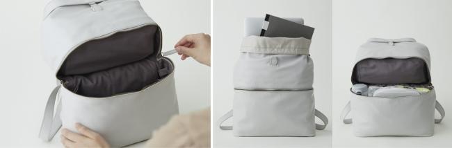 袋子里面是一个可以打开和关闭的隔板,可以分成两层来存放行李。