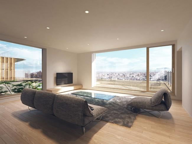 床材はもちろん、窓から見えるファサードまで、 視界のそこかしこに木のぬくもりを感じられるリビング
