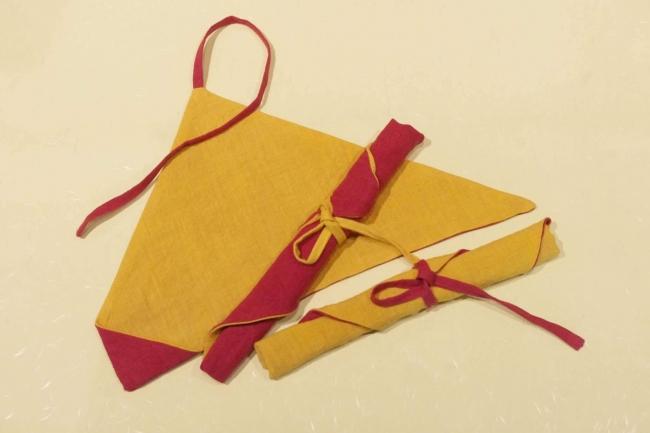 椿灰を媒染につかい、五島椿と鎌倉の紅葉をイメージした配色で染めた箸ケース