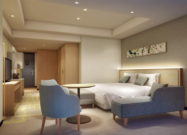 【デラックス】34㎡超のゆとりがあり、ベッドの足回りにも十分なスペースを確保。