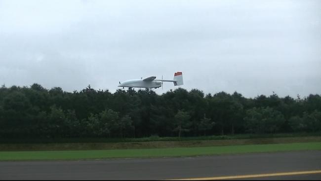 100km自動航行に成功した自社開発機体の飛行中の様子