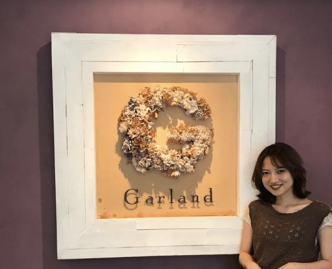 リバースプロジェクトから代表・榊原章哲に送られたオブジェがGarlandのシンボルとなっている。