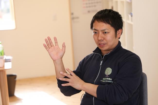 今回、保育士の仕事の重要性と可能性を実感できたと語る市村弘貴園長