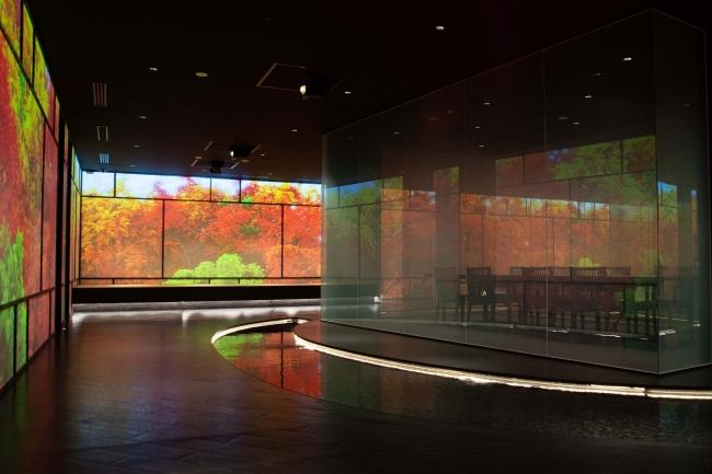 壁面を利用したプロジェクションと水で演出した和の雰囲気のエントランス