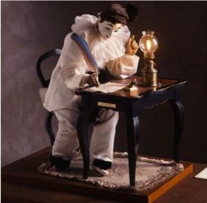エクリヴァン(自動人形) 手紙を書く仕草をするピエロが  居眠りをします。再び目覚めた後、消えかけたランプに火を灯し直して、手紙を書く仕草を続けます。