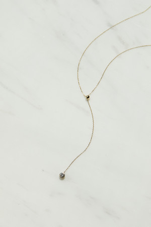 0.1ct Slide Lariat Necklace/57,200円(税込)