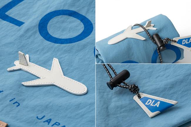 「旅」をテーマに、遊び心あるデザインが随所に。アジャスターの「DLA」(右下)は、DOUBLELOOP AIRLINEの意。「旅への案内人」としての、さすがの演出!