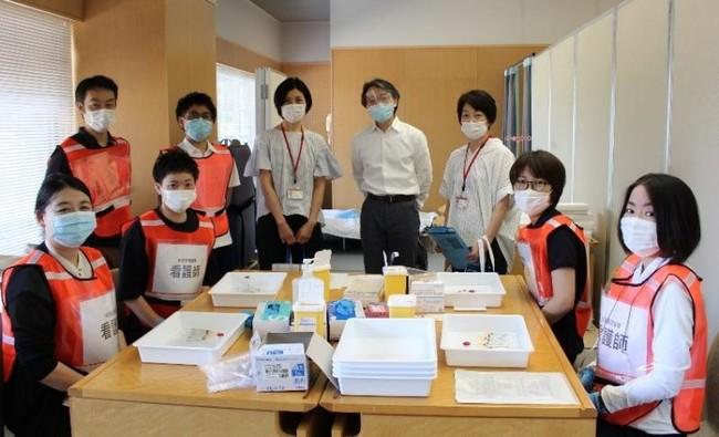 一丸となって集団接種に協力する岡山大学病院の職員ら