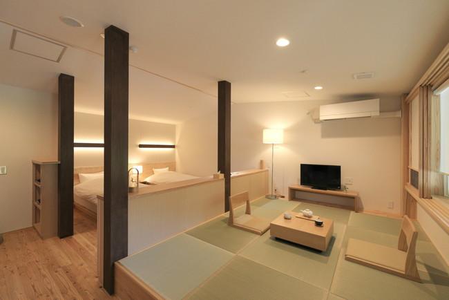 源泉かけ流しの客室風呂を備えた、ラグジュアリーな和洋室ツイン
