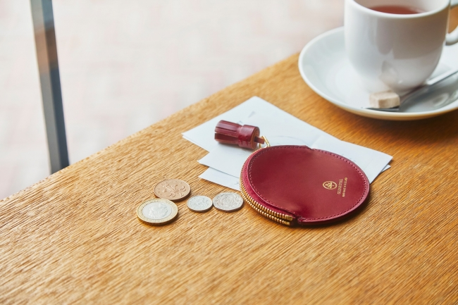 CIRCLE COIN CASE WITH TASSEL PULLER ¥15,000+TAX