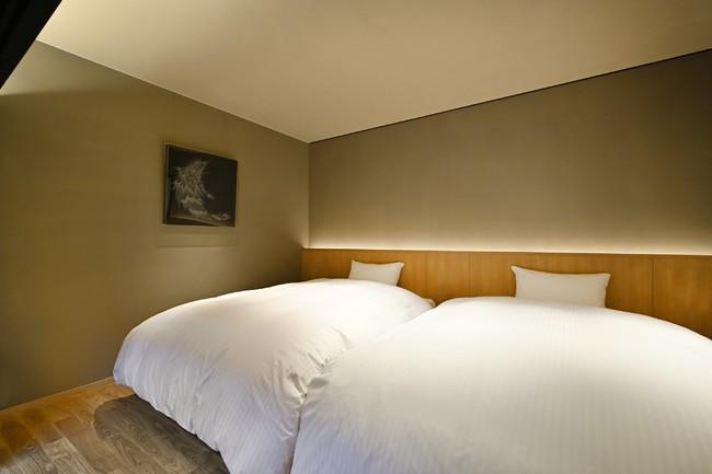 ベッドルーム  シモンズ製のセミダブルベッドが2つ並ぶ
