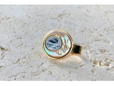 【沖縄 カヌチャリゾート】太陽の光で真珠の輝きを放つ大浦湾産「夜光貝」で作られた、ワンポイントのオリジナルアイテム「ゴルフマーカー」1月25日より発売開始